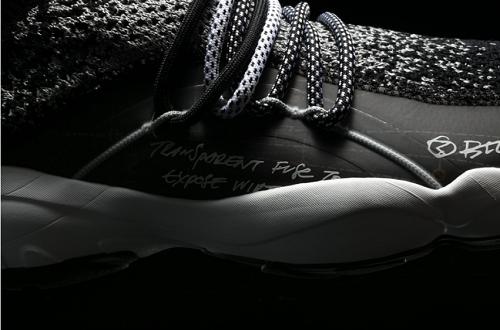 鞋面第二部分使用静态图案的黑色和3M反光材质针织。