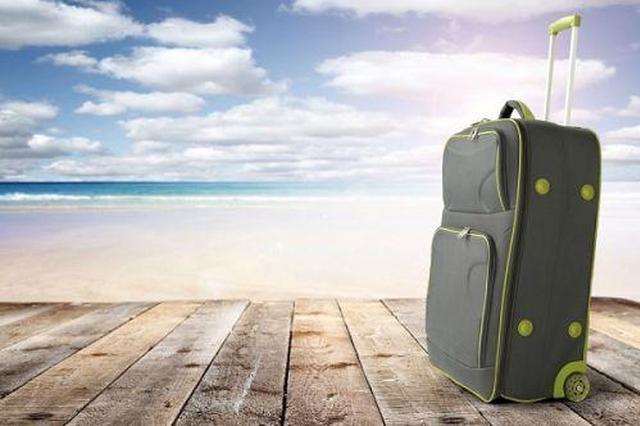 重庆游客西安旅游落下行李箱 的哥停运找失主