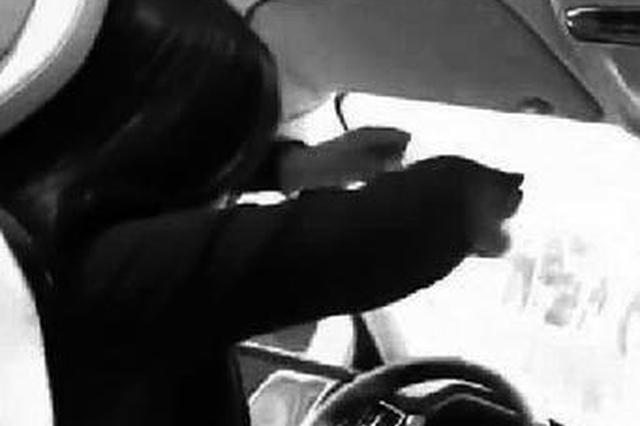 "4S店女销售""双手撒把""开车拍视频 交警:将处罚"