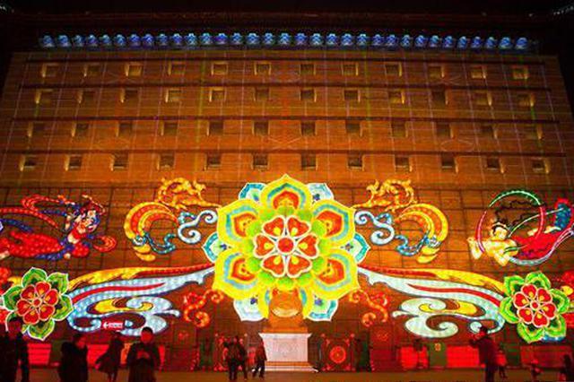 西安城墙传统彩灯披上科技新装 游客:像穿越到大唐盛世