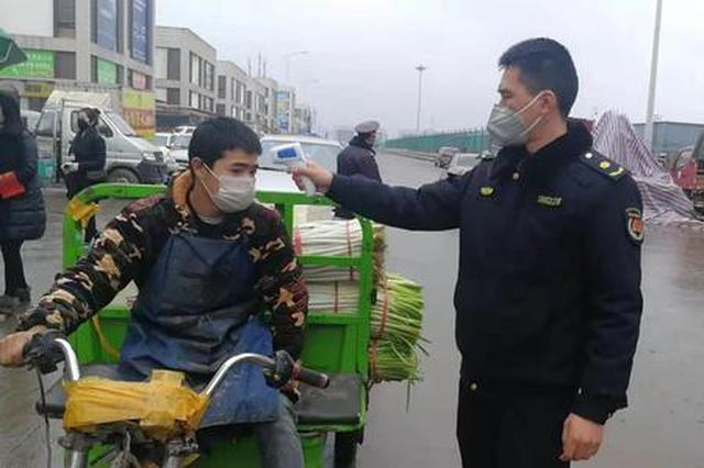 清明假期西安城管系统开展环境整治 取缔流动摊贩1260户