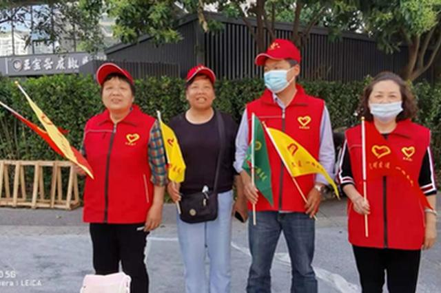 """西安高新区平安志愿者""""上岗"""" 文明引导护航十四运"""