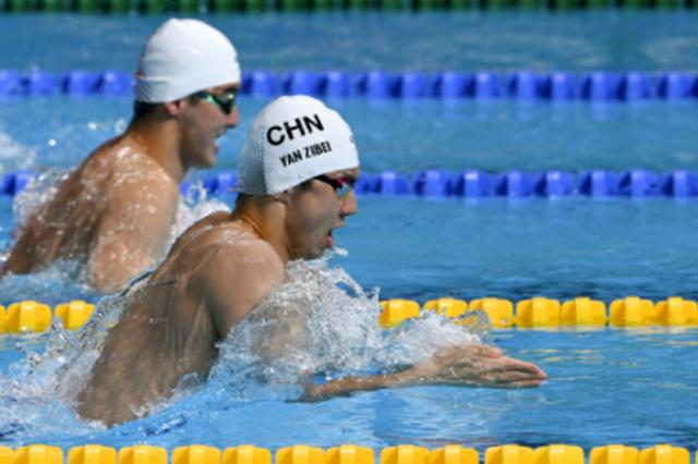 湖北选手闫子贝卫冕全运会游泳男子100米蛙泳冠军