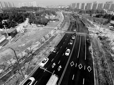 长安学府大道中段市政道路昨通车 方便市民出行