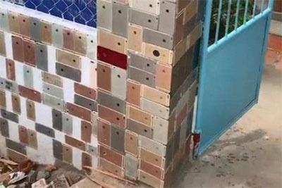 越南男子用iPhone建围墙 维修手机15年终于走上巅峰