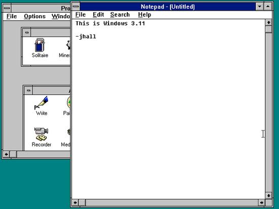 Windows 3.11 上的程序管理器和记事本编辑器
