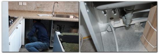 安装师傅检查橱柜内部的电源管线位置