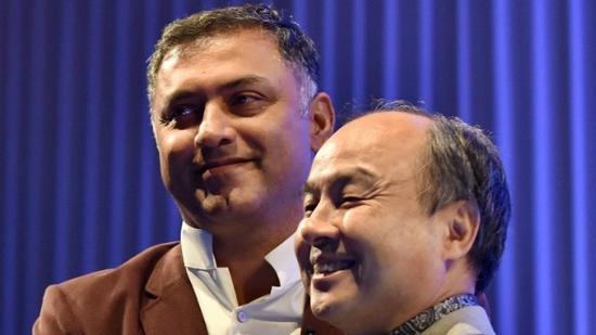 图注:软银总裁NikeshArora和首席执行官MasayoshiSon。©法新社