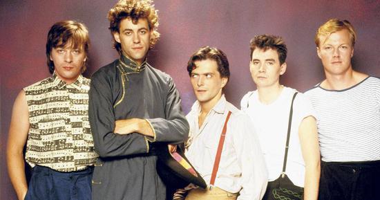 人怕出名猪?#20262;常?#21809;完Live Aid,乐队就因鲍勃(左二)单飞而解散了 | buzz.ie