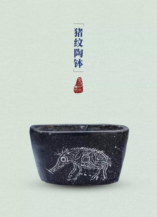 刻画着猪脸的陶壶