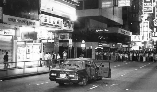 忠信表行劫案现场,弥敦道,1985年