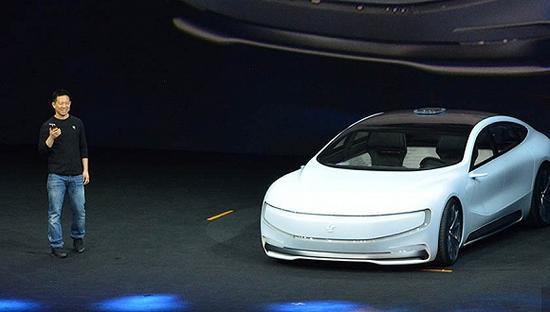 图片来源:2016年4月贾跃亭在乐视汽车发布会现场。