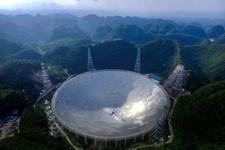 FAST即将竣工,如何正确谈论贵州这个山一样大的望远镜?