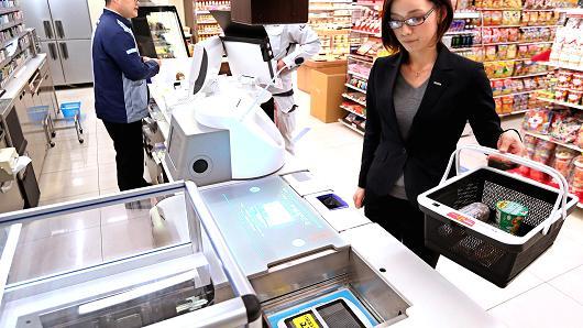 松下测试机器人收银员收款和装袋一条龙