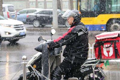 北京降温迎雨雪天气 专家释疑3月下旬飘雪正常吗?