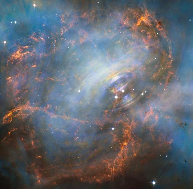 """图中是位于蟹状星云中的一颗脉冲星,最新一项研究大胆猜测称,外星人可能对脉冲星进行操控,将其释放的电磁脉冲进行信息编码,作为""""导航灯塔""""。"""