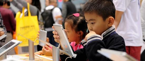 人民日报署名文章:让企业在中国市场轻装前行