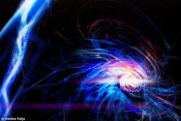 """科学家终于创造出了被称为Shankar斯格米子(Shankar skyrmion)的神秘粒子,距离它首次被理论提出已经过去了40多年。而且,科学家在这一过程中可能还模拟出了罕见的""""球形闪电""""现象。上为艺术想象图。"""