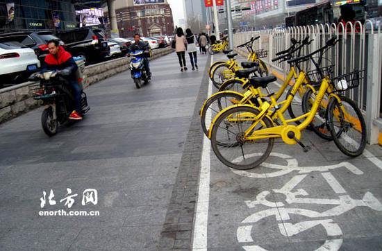 规范共享单车区域让市容更美丽市民出行更便捷