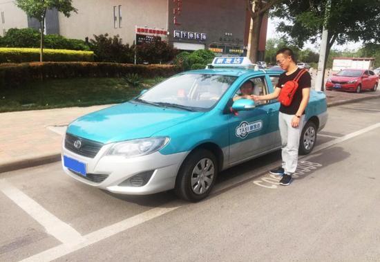 天津2万出租换新貌 滴滴出租车倡 新车 新体验