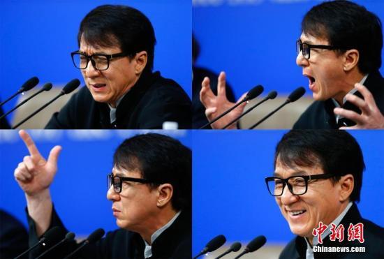 """3月7日,全国政协十二届五次会议在北京梅地亚两会新闻中心召开""""政协委员谈坚定文化自信讲好中国故事""""记者会。图为成龙委员答记者问。"""