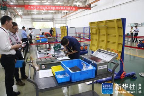 首届中国民航机务维修岗位职业技能大赛比赛现场。(新华视觉 庞杰 摄)