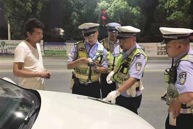 未挂号牌上路被查 用过期临牌避处罚 司机被记12分
