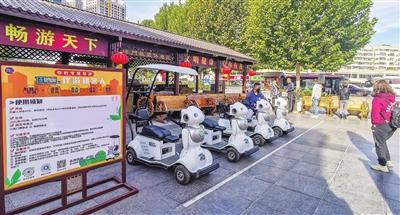 伴游机器人亮相古文化街(图)