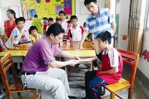 户籍残疾儿童入读 普通幼儿园享补助