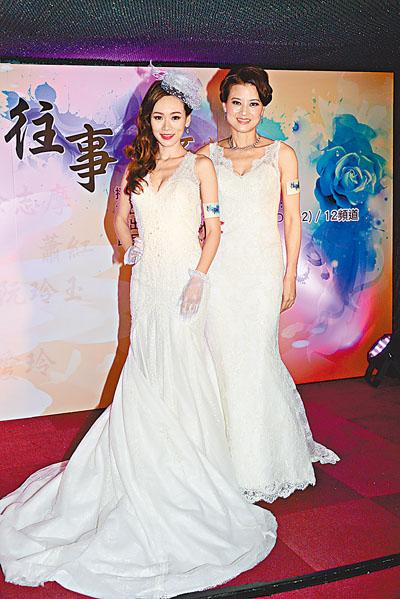 杨思琦与黎燕珊穿上婚纱列席记招
