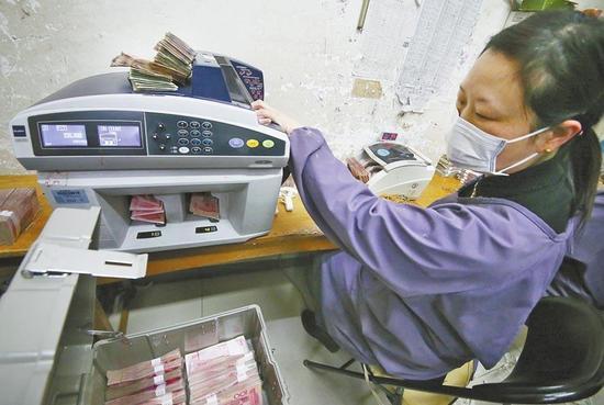 洛阳一企业用残损纸币发电 一年百万度