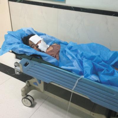 小雨菲身负重伤,躺在病床上