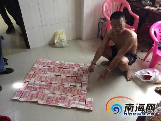 符某群指认自己三兄弟诈骗来的50多万元现金。
