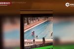 监控:4岁女童横穿泳道 被外籍男子举起扔进水