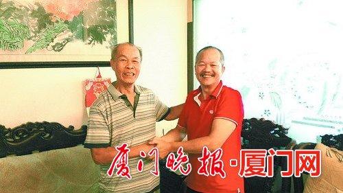 ■周育辉(右)和林金裕26年后再相见。