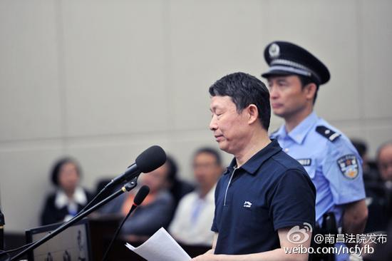 8月11日,被告人李崇禧在庭审现场。