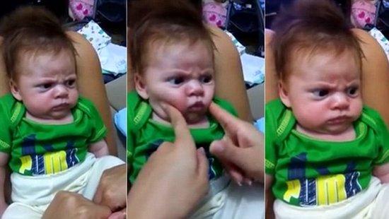 """无论妈妈怎么逗他,这位墨西哥的小宝宝都拒绝""""笑笑""""(网页截图)"""