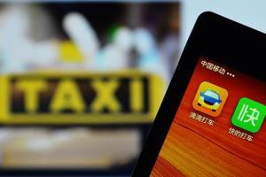交通部专车新规:纳入出租车管理 实行许可制