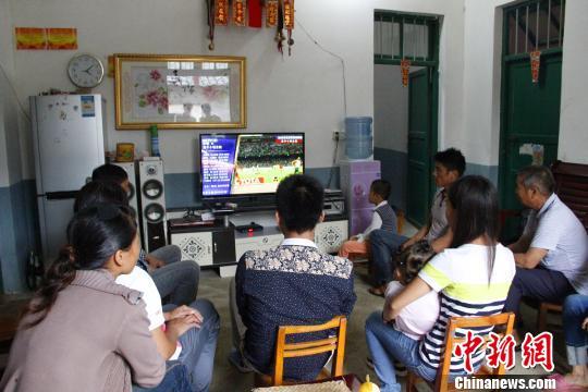 莫有雪的家人在观看北京田径世锦赛。