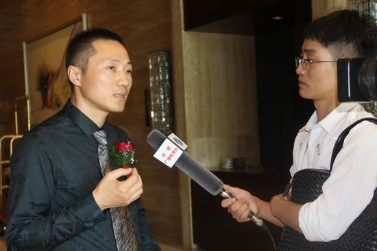 安徽合融投资的执行董事兼总裁周圣华先生接受媒体采访