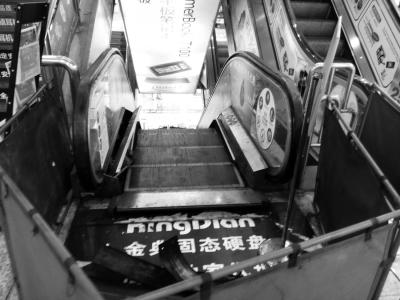 ▲故障扶梯已被围了起来