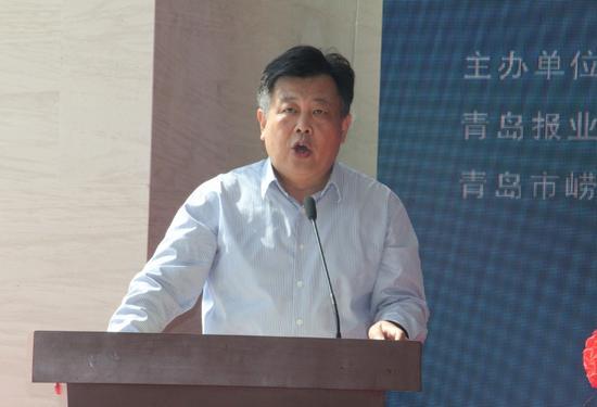 青岛日报社总编辑、党委副书记余钦伟致辞
