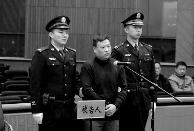 李振海出庭受审。法院供图