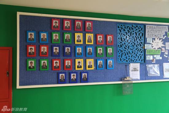 墙上贴着学生会成员以及学校形象大使照片