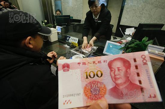 新版人民币百元钞票今日上午亮相