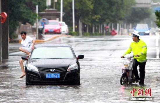 资料图:京津冀迎来强降雨。中新社记者 张道正 摄
