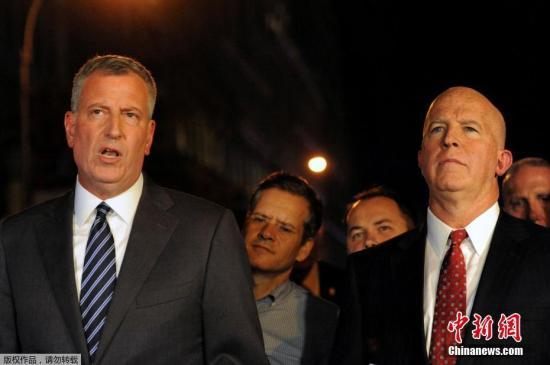 資料圖:紐約市市長白思豪(左)。