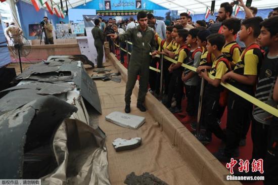 本地工夫9月21日,伊朗德乌兰,伊朗初次对中公然展出积年去击降战捕捉的好国无人机。