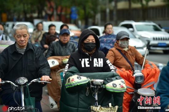 资料图:受冷空气影响,中国多地气温骤降。可里 摄 图片来源:IC photo