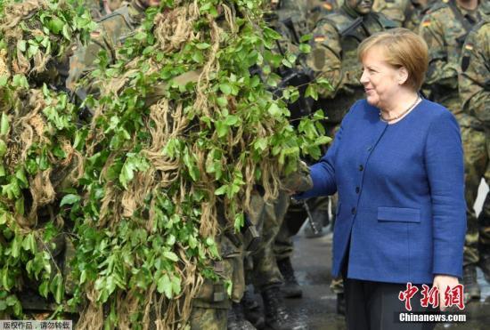 材料图:德国总理默克我。